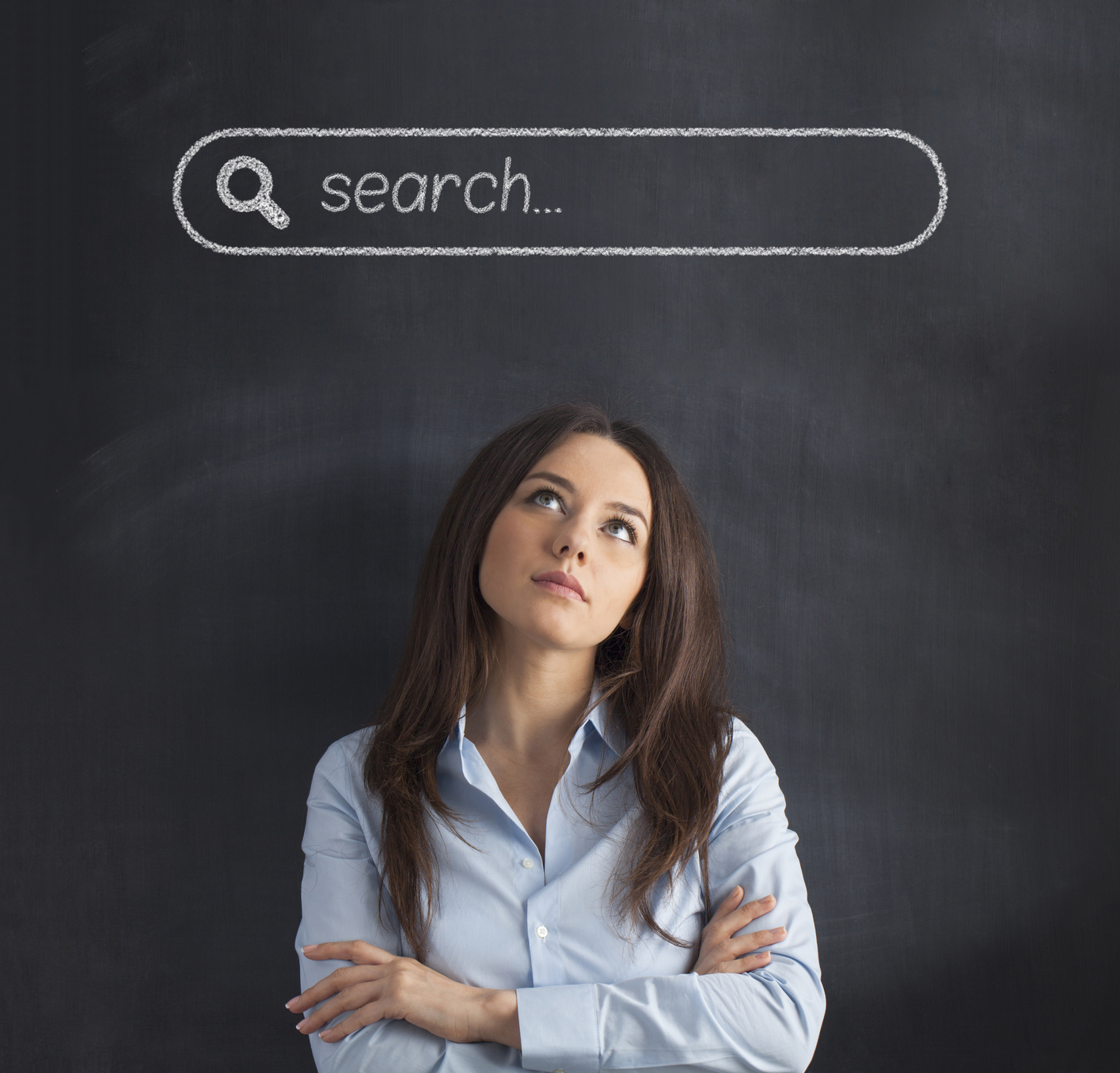 Businesswoman standing on blackboard under the search bar