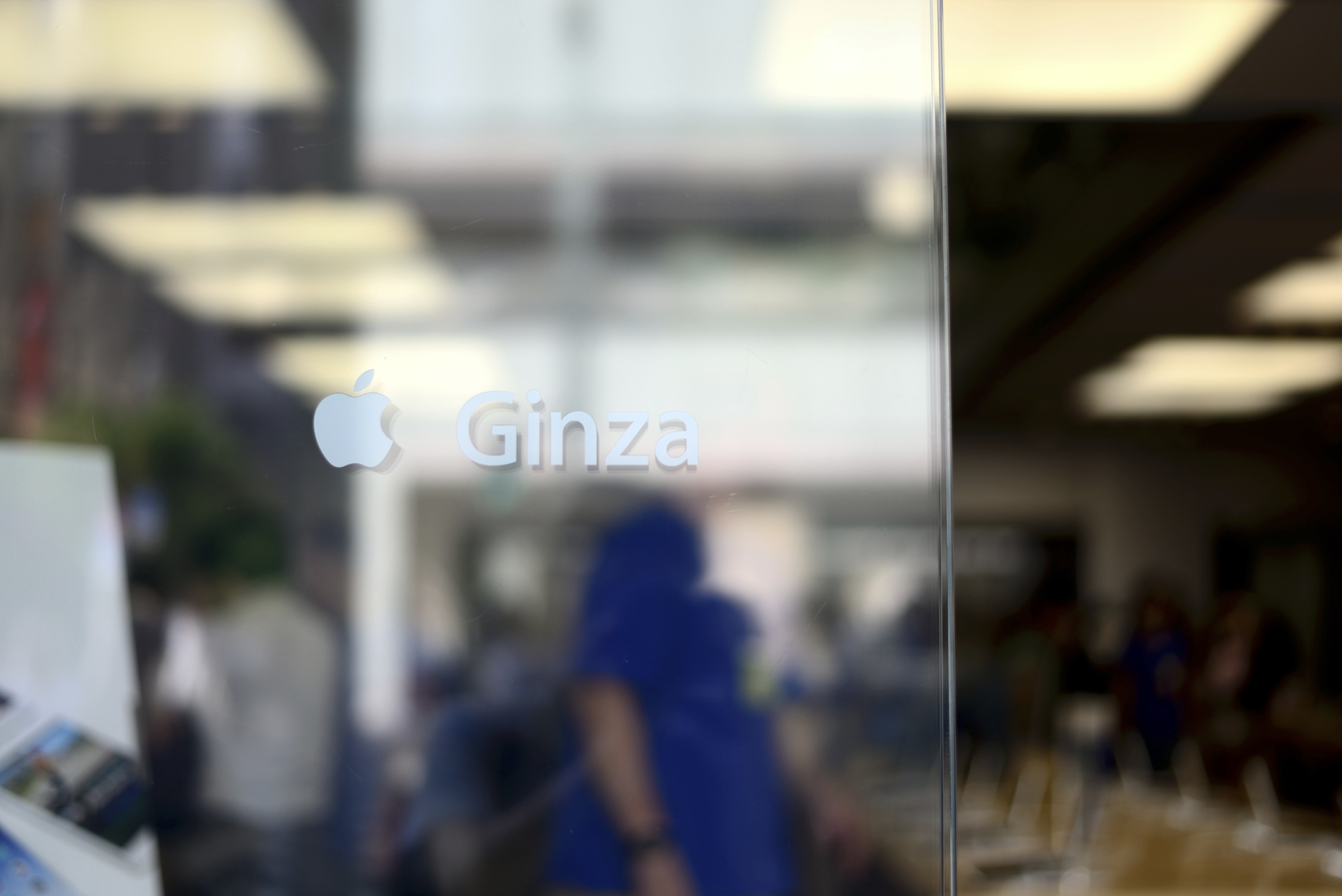 Tokyo, Japan - May 30, 2014: People shopping at an Apple store in the upscale district of Ginza.