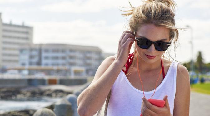 Beautiful young woman using smart phone
