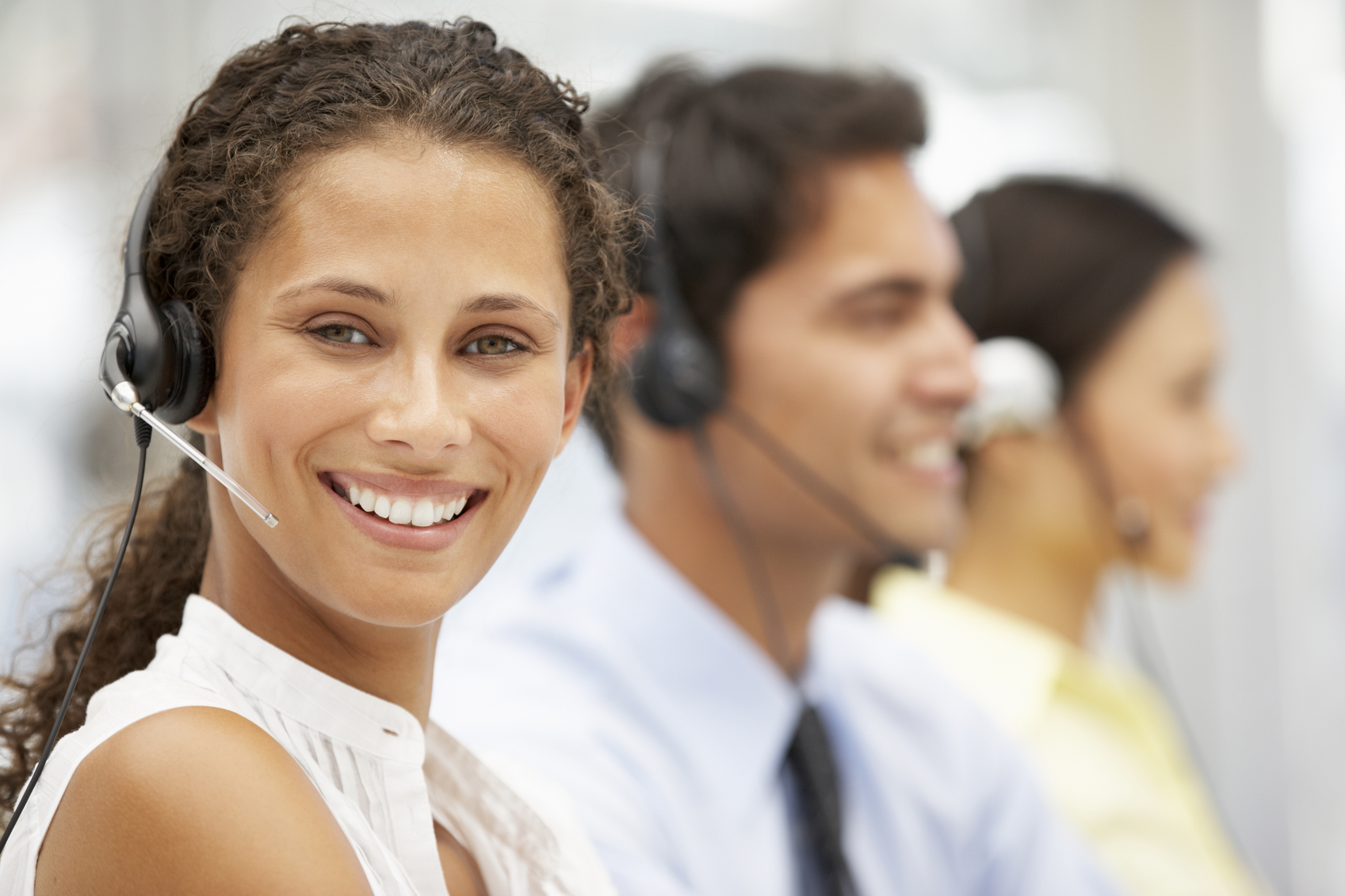 Businesswoman wearing headset in call centre