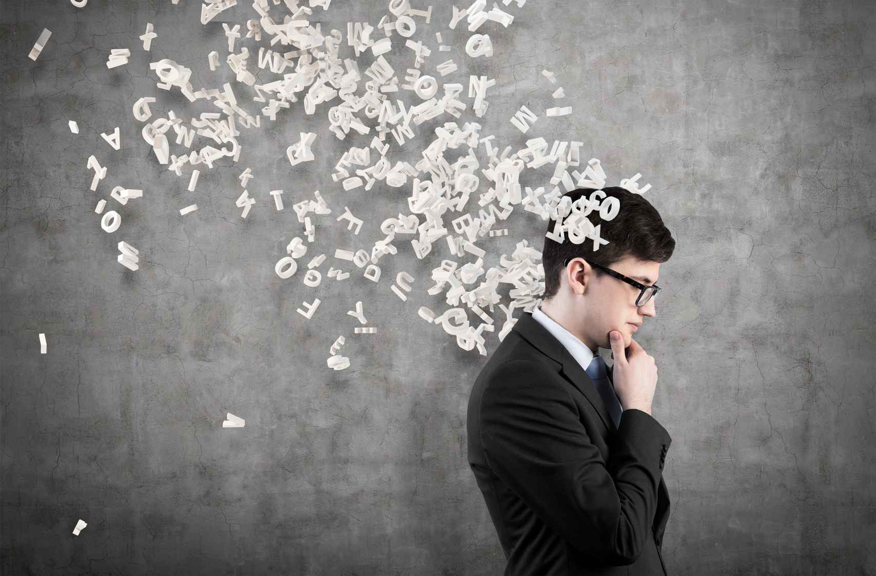 businessman thinking with flying letters