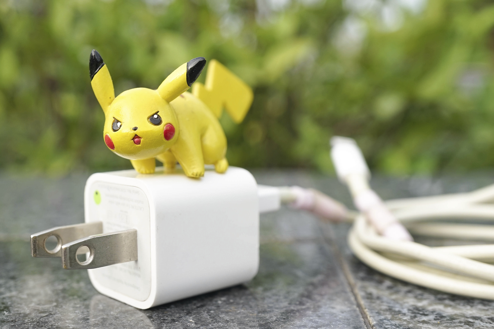 Ayutthaya, Thailand - July 30, 2016 : Closed up of Pikachu on top of electronic plug. Pikachu is electronic type pokemon. Concept of Pokemon, a big hit application after its launched in July 2016. Editorial Used Only.