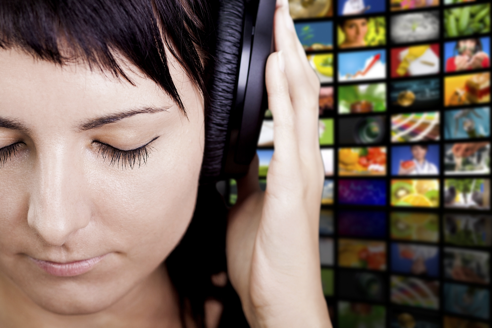 Young woman with headphones, enjoying nice music.