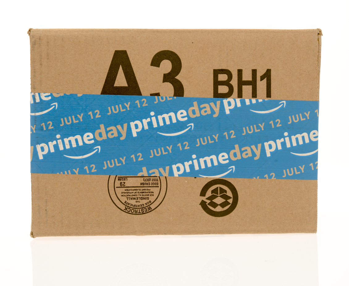 Winneconne, United States - July 5, 2016: Amazon box with Amazon prime day advertising for July 12 on an isolated background.