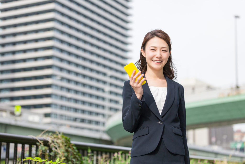 Japanese business woman holding a smart phone