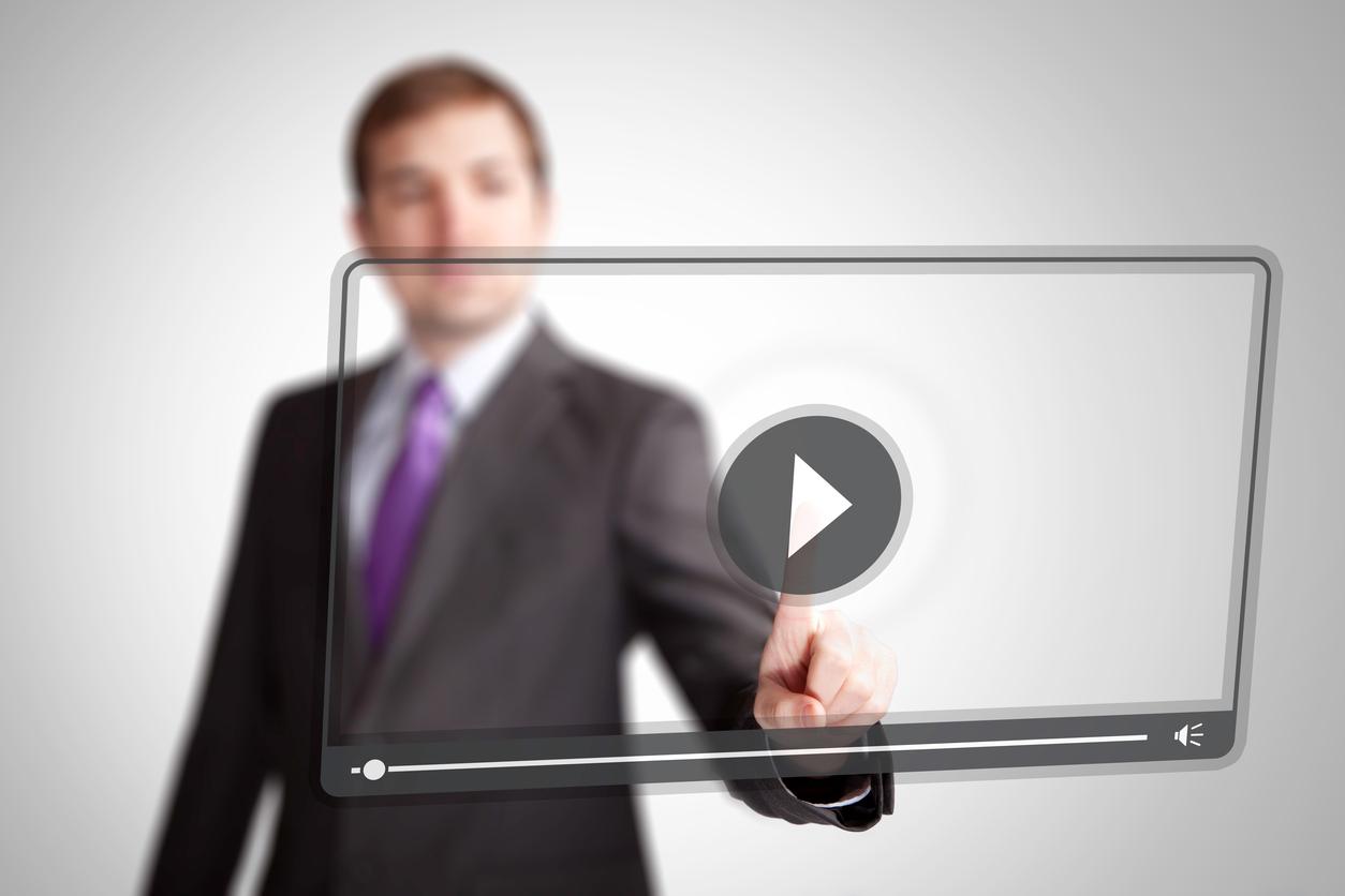 Man press video play button