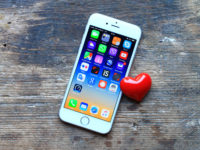 New gray iPhone 6 and small red heart