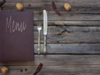 Vintage restaurant menu on a rustic wood background