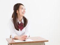 Schoolgirl sitting at a desk