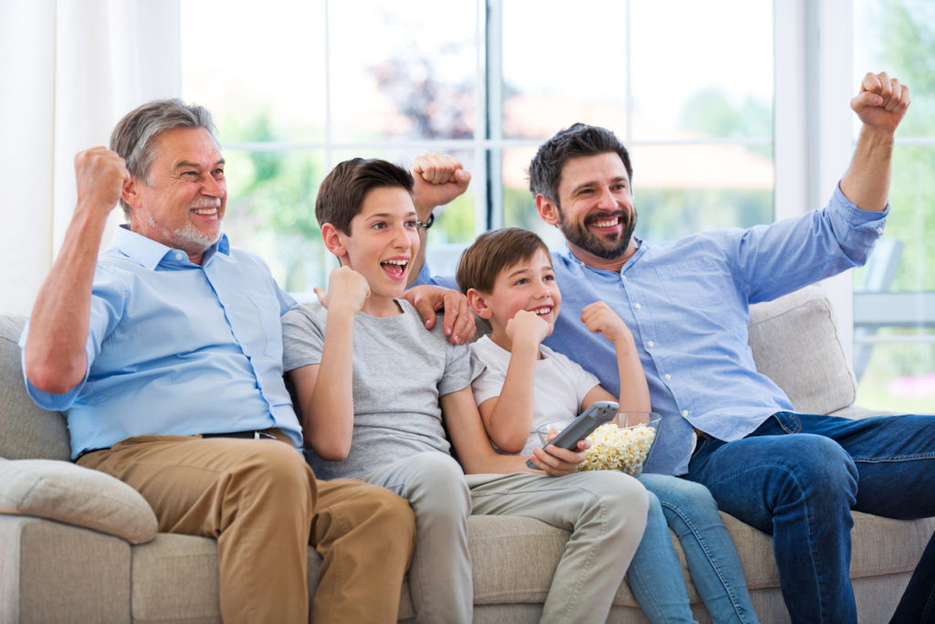 Family watching football match on telly