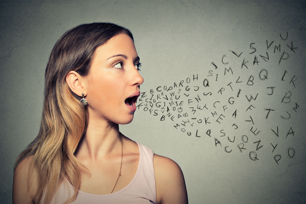 Woman talking alphabet letters coming out of her mouth