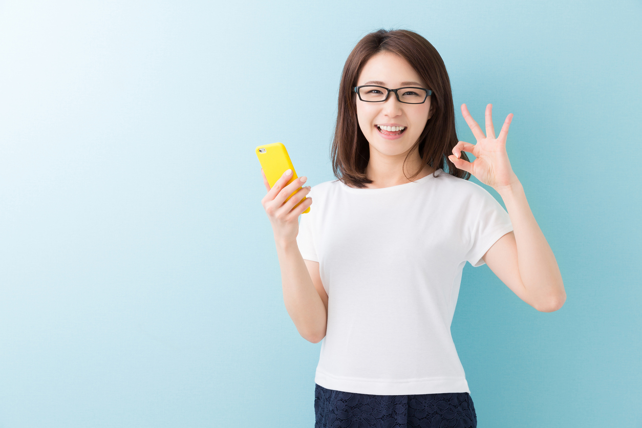 Japanese woman holding a smartphone