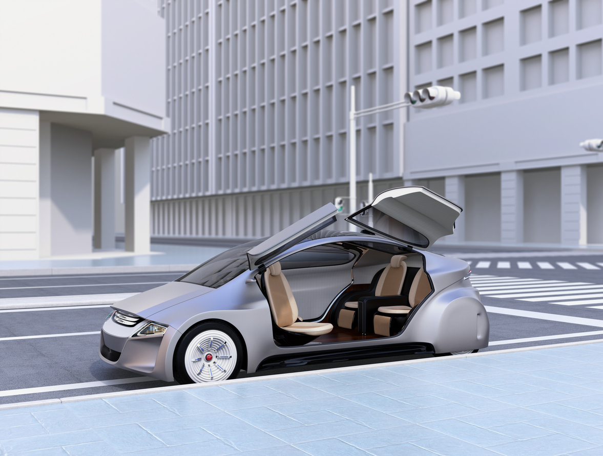 Silver autonomous car parking at the side of the road