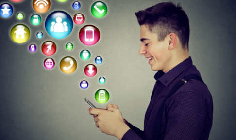man using smartphone with social media application icons