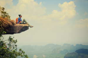 young asian woman enjoy the view at mountain peak
