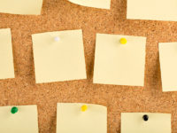 Cork board with sticky notes.