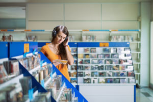 girl listening to music in cd store