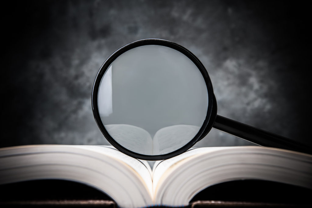 magnifying glass on the book