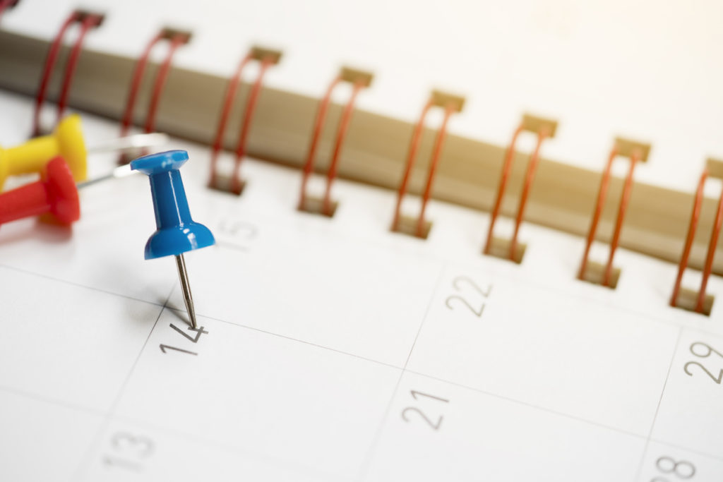 Closeup of dates on calendar page planning