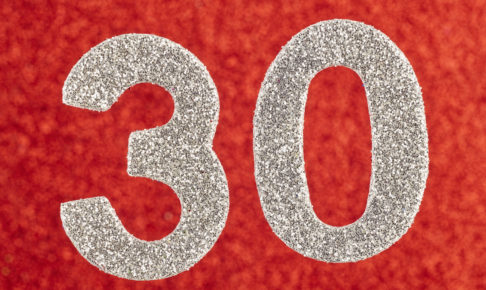 Number thirty silver color over a red background. Anniversary. Horizontal