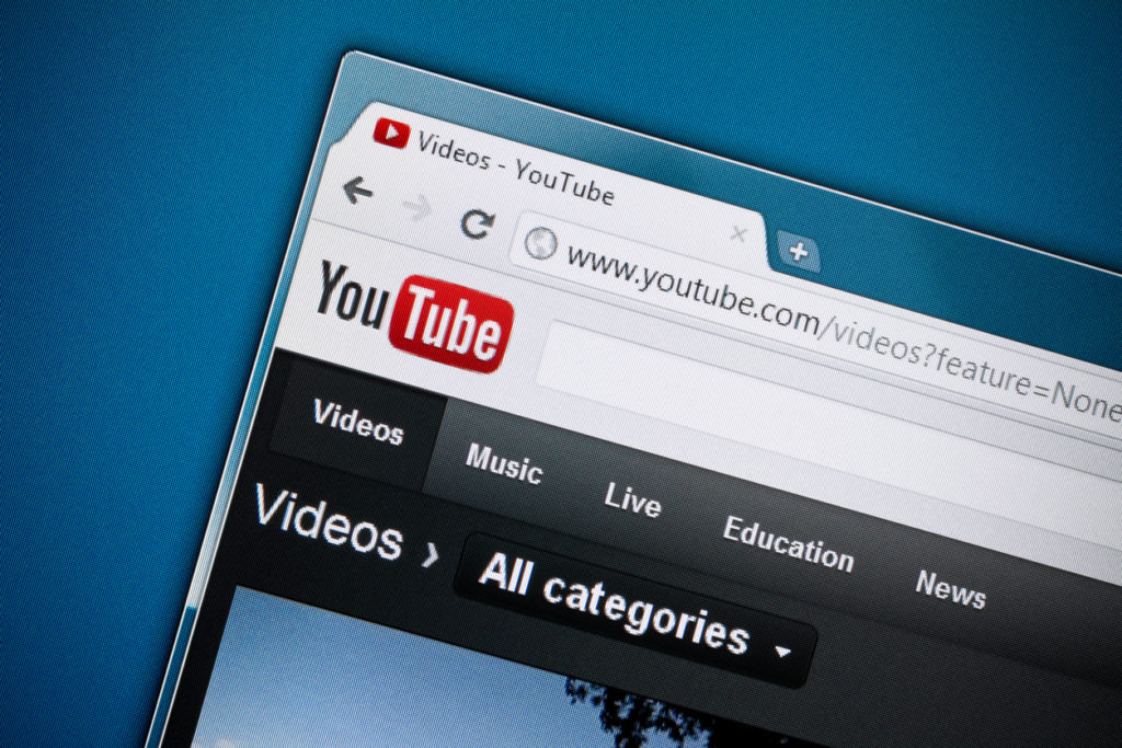YouTube homepage against a blue background