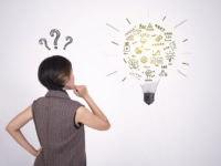 thinking business women with question mark and idea lightbulb.