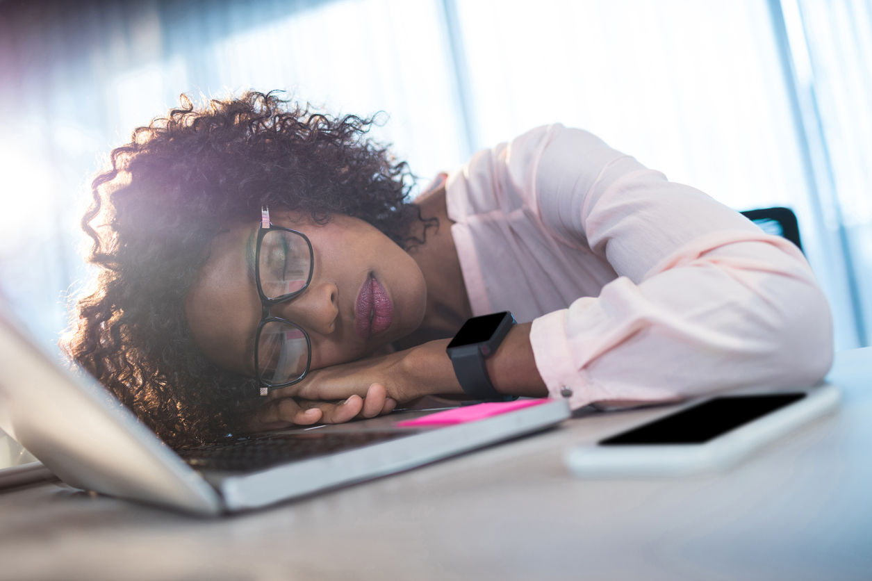 Businesswoman sleeping on her desk