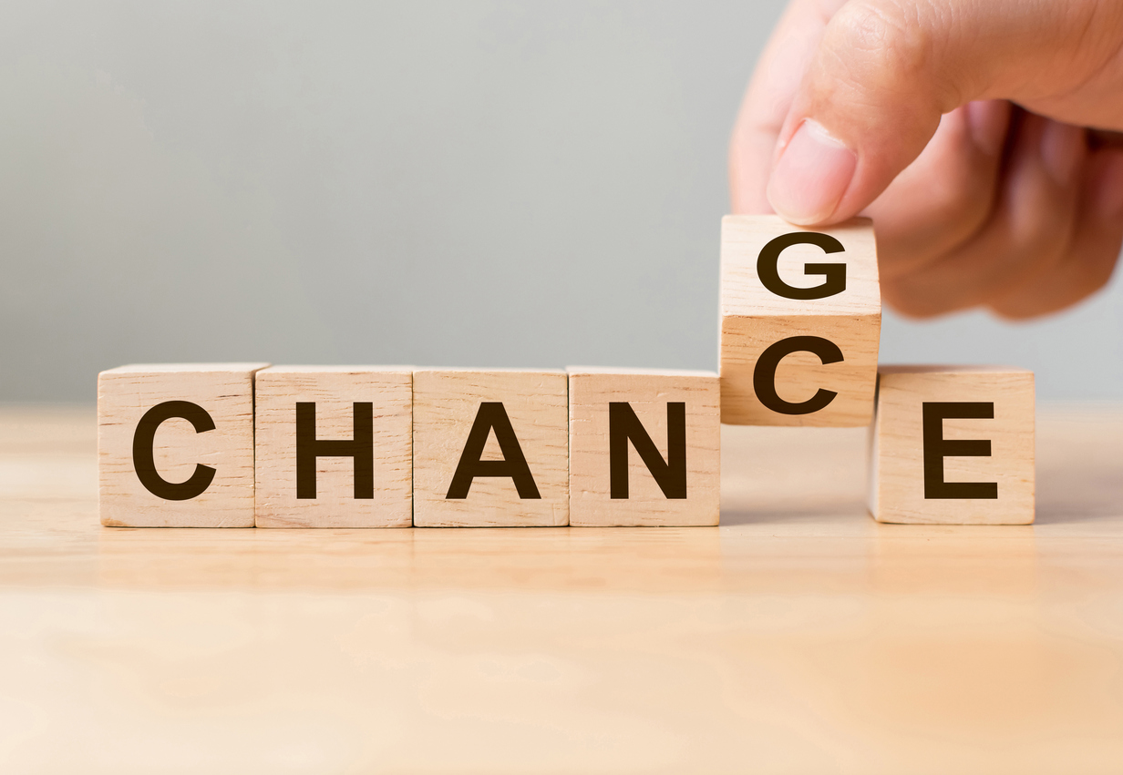 "Hand flip wooden cube with word ""change"" to ""chance"", Personal development and career growth or change yourself concept"