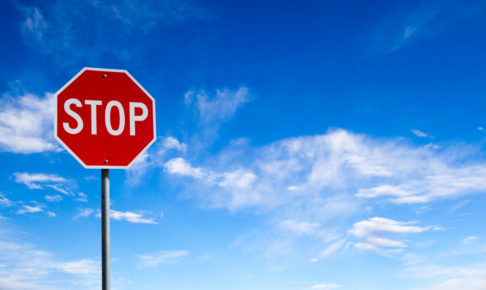 Stop Sign With Blue Sky Background and Copy Space