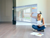 Woman decorating with virtual reality glasses