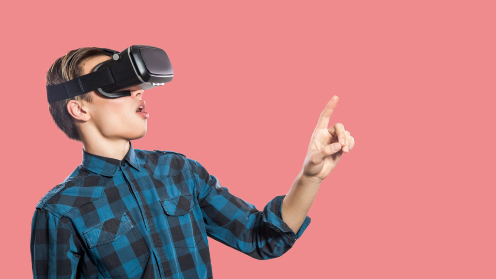 young-man-with-vr-headset-on-pink-background-picture-1