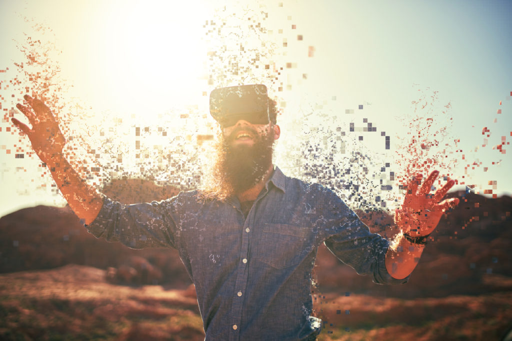 bearded guy in desert wearing vr glasses