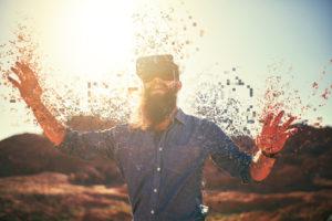 bearded guy in desert wearing vr glasses