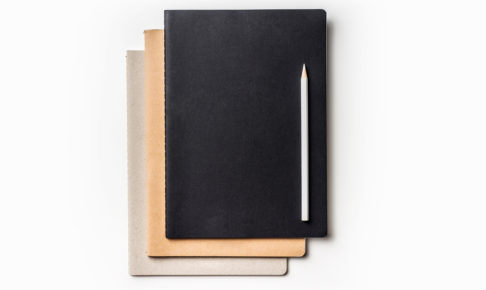 Top view of many notebooks and color pencil