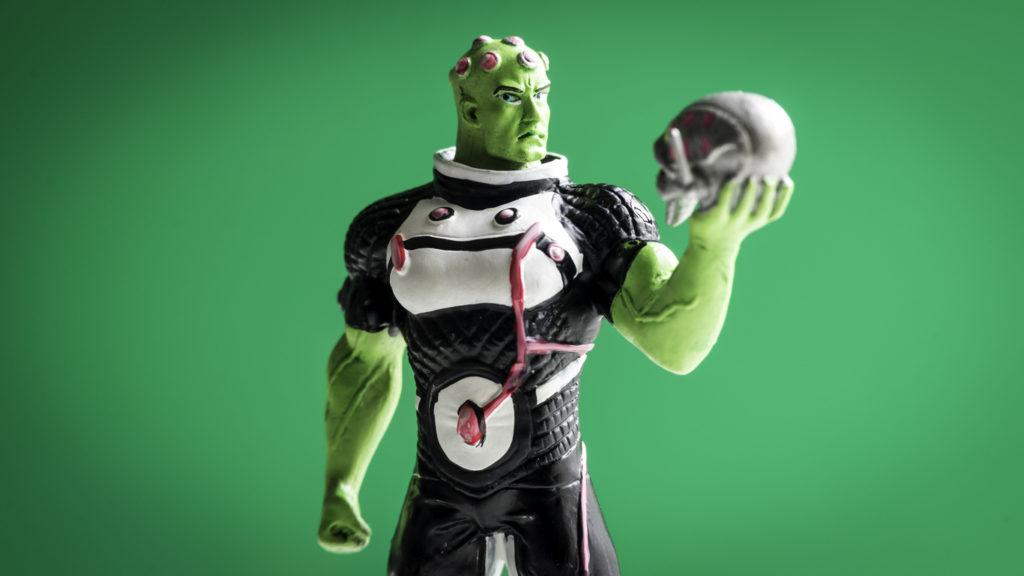Closeup hand painted figurine of Brainiac, a super-intelligent alien being