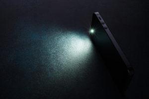 Lantern smartphone shines on a dark background.