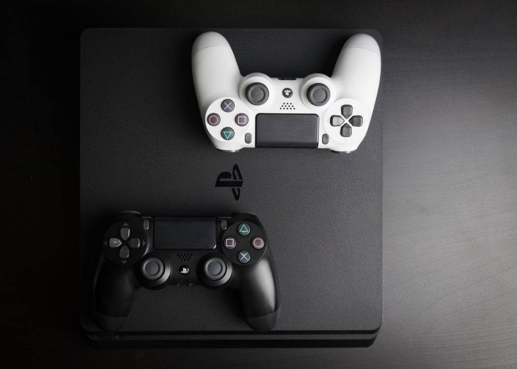 Sony PlayStation 4 Slim 1Tb revision and game controller