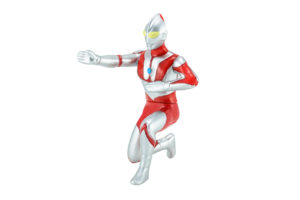 Ultraman is kneeling but in a classic battle