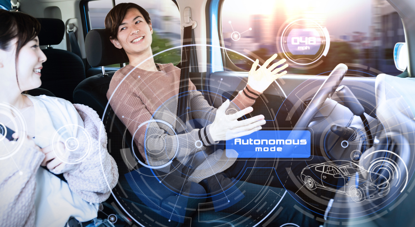 Young couple riding autonomous car.