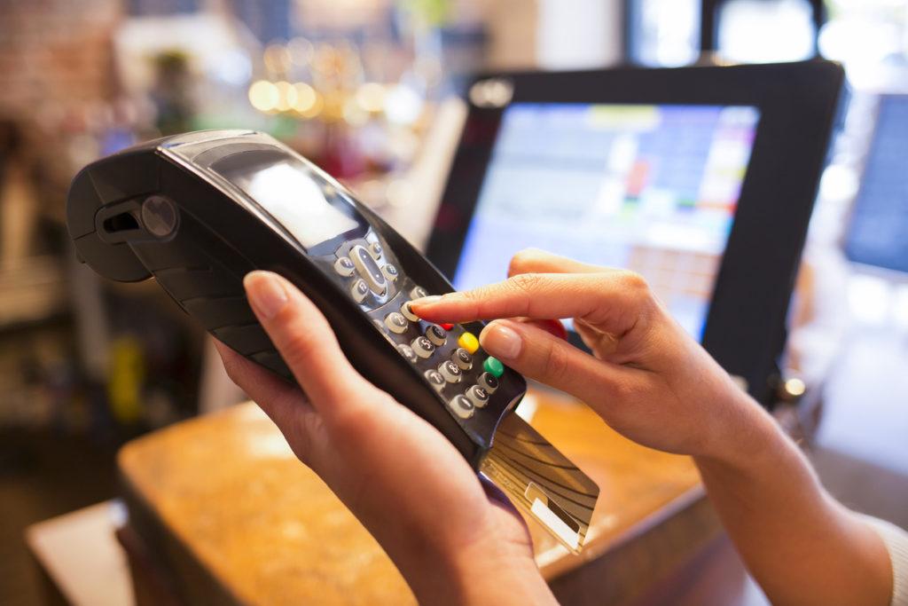 Female payment electronic reader close-up shop plastique card button