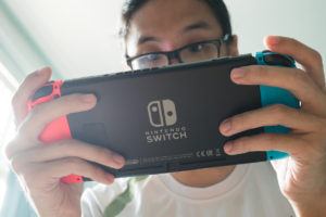 A man playing Nintendo Switch.