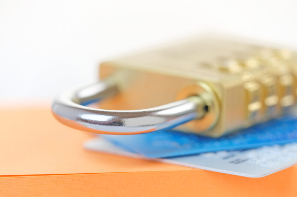 Padlock on credit cards. Card security concept with shallow dof.