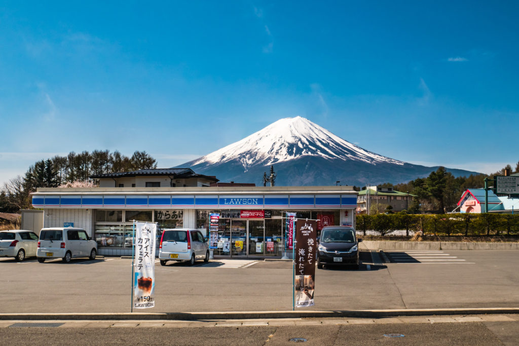 Kawaguchi, Japan - April 20, 2017: Lawson, convenience store franchise chain in Japan with Mount Fuji in background.