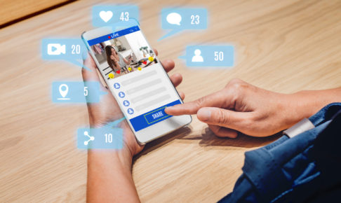 woman share view of beauty blogger review online with mobile apps on wood table at home,online influencer technology in daily lifestyle,Digital age concept.