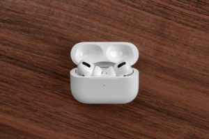 Apple AirPods Pro on a wooden table.