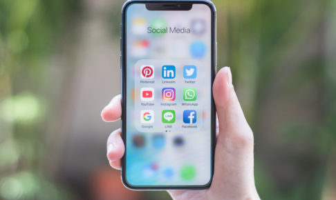 Social media app icons on Iphone X screen