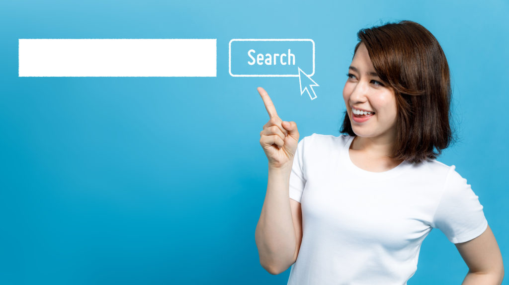young woman pointing at the search bar.