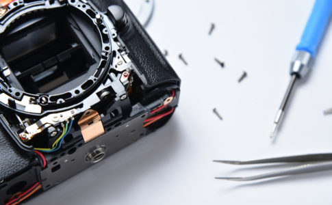 Electronics repair in a service center, disassembled camera.