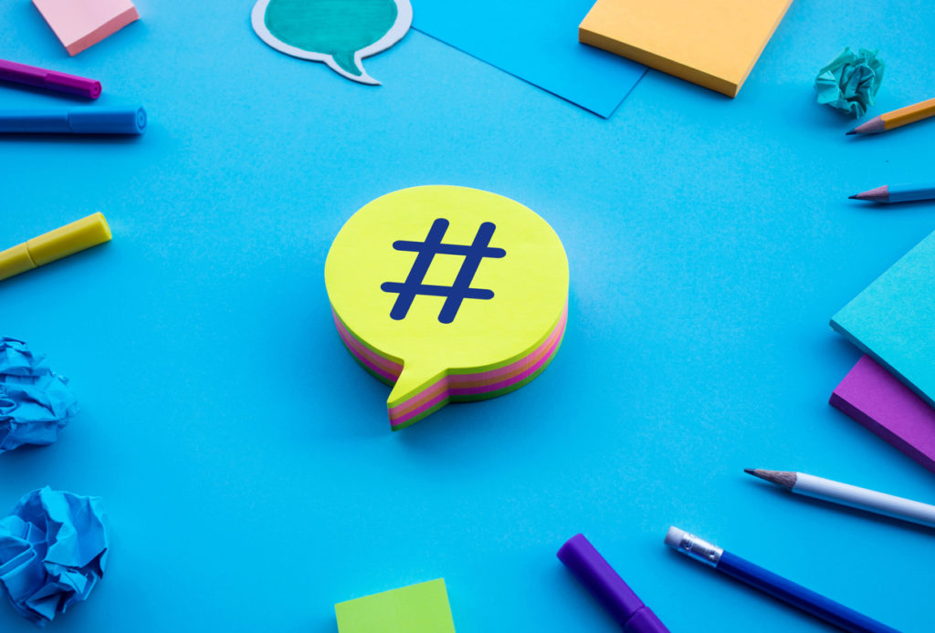 Post text on chat,speech bubble on blue desk table color background.social media and online marketing