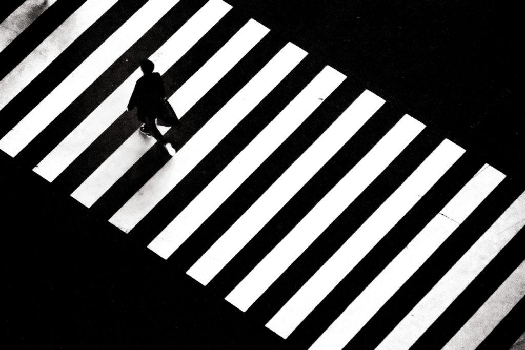 A man walking across zebra crossing